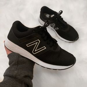 Black New Balance athletic sneaker